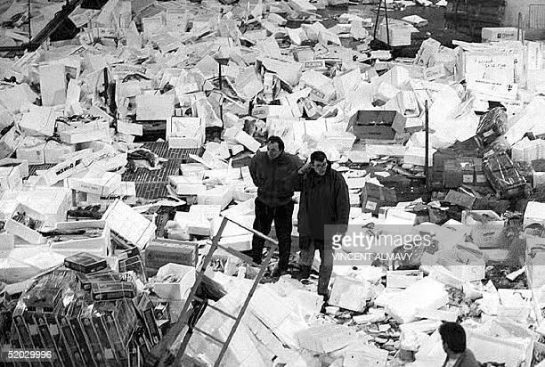 Two inspectors view the surroundings at Les Halles de Rungis France's largest wholesale fish market after several hundred Breton fishermen clashed...