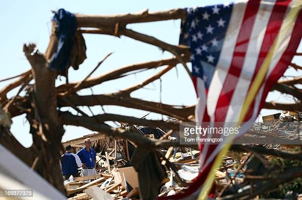 Two insurance adjusters survey a destroyed home on May 23 2013 in Moore Oklahoma The tornado of at least EF4 strength and two miles wide touched down...