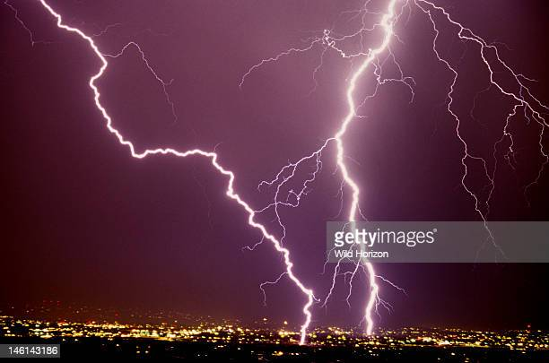 Two intense cloudtoground lightning strikes one of which is an excellent example of zigzag lightning Tucson Arizona USA