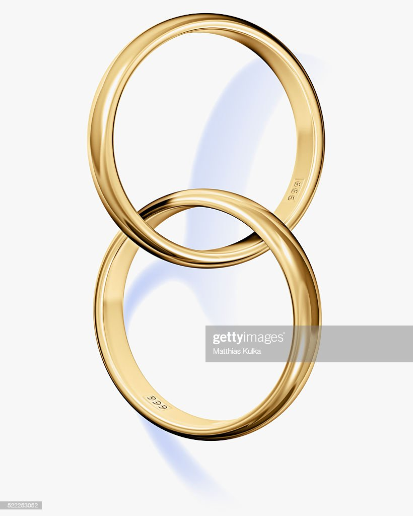 Two Interlocked Wedding Rings Stock Photo Getty Images