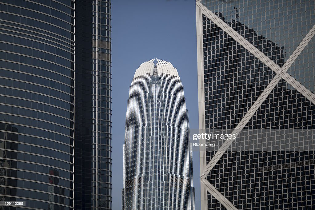 Two International Finance Center (IFC), center, is seen between ICBC Tower, left, and Bank of China Tower in the central business district of Hong Kong, China, on Saturday, Jan. 5, 2013. Hong Kong topped the ranks as the most expensive office market by total occupancy cost, according to a report by CBRE Research released on Jan. 7. Photographer: Jerome Favre/Bloomberg via Getty Images