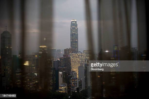 Two International Finance Center center stands in the Central district in Hong Kong China on Tuesday Oct 8 2013 Property market imbalances are still...