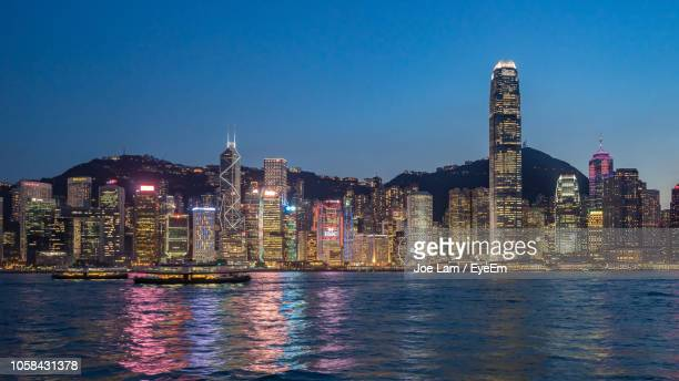 two international finance centre at victoria harbour in city during night - two international finance center stock pictures, royalty-free photos & images