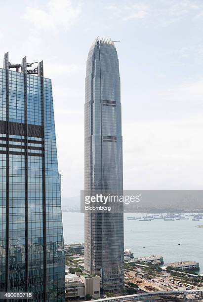 Two International Finance Centre center stands in the Central district of Hong Kong China on Wednesday May 14 2014 Hong Kong is scheduled to release...