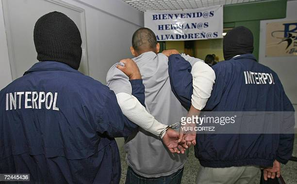Two Interpol officers lead Juan Elias Rodriguez Luna a member of youth gang 'MS' upon his arrival at the international airport in Comalapa 07...