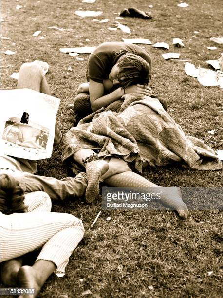 Two intertwined couples napping on the grass with a quilt covering a woman in fishnet stockings at the 1st Elysian Park Love-In on March 26, 1967 in...