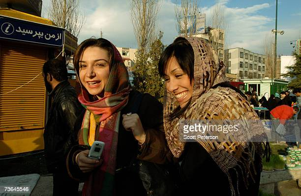 Two Iranian girls laugh as Iranians shop in Tajrish Square to buy special items to celebrate Nowruz March 20 2007 in Tehran Iran Iranians...