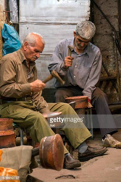 two iranian handicraft makers inside their shop - isfahan province stock pictures, royalty-free photos & images