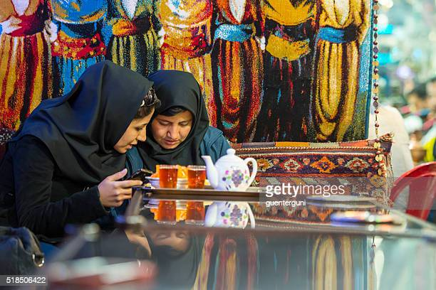 two iranian women in a traditional tea house, isfahan, iran - iranian woman stock photos and pictures