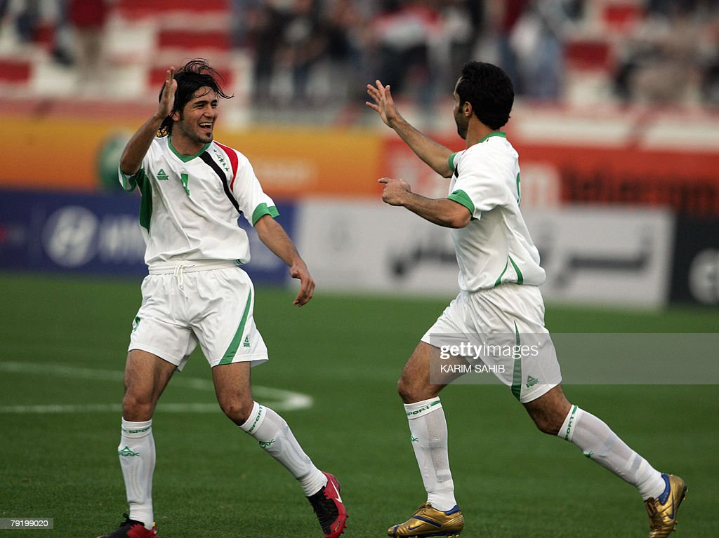 Two Iraqi national football team players jubilate at the end of their friendly match against Jordan in Dubai 24 January 2008. The game ended in a 1-1 draw.
