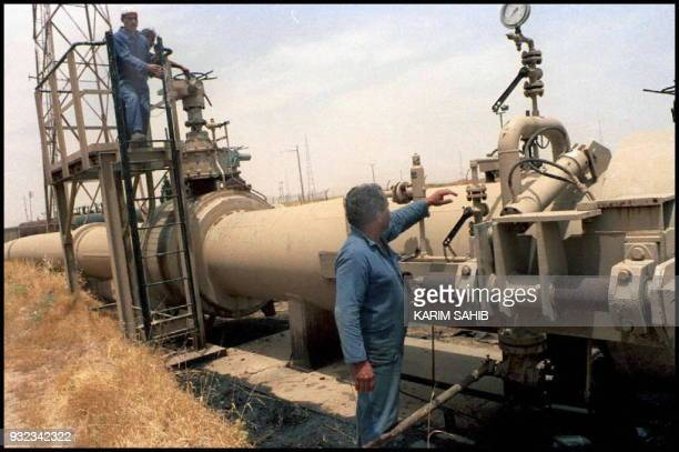 Two Iraqi oil technicians checking puming equipment at Kirkuk oil pump station minutes after the start of oil pumping to Turek's yumurtalik port on...