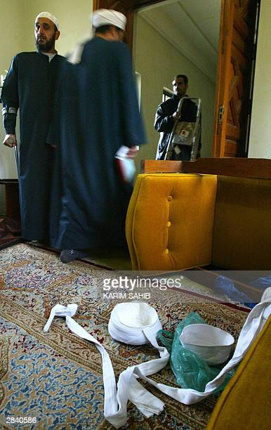 Two Iraqi Sunni Muslim clerics stand 02 January 2004 in the room at Baghdad's Ibn Taimiya mosque where imam Mahdi Ahmed Saleh alSumaydah was arrested...