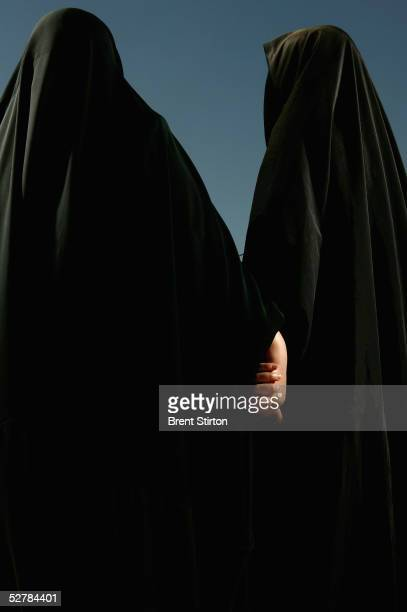 Two Iraqi women are photographed June 14 2004 in Baghdad Iraq This image is a comment on the solidarity of traditional Iraqi women in the face of the...