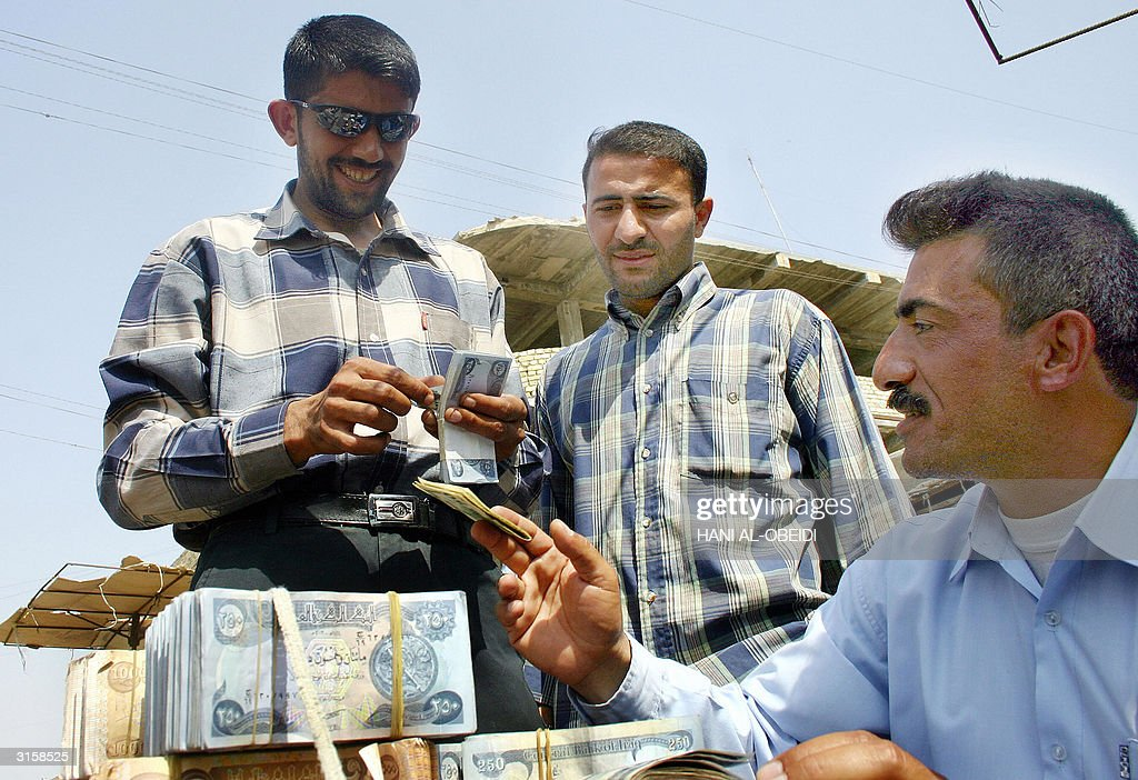 Two Iraqis Exchange Iraqi Dinar For Us D News Photo