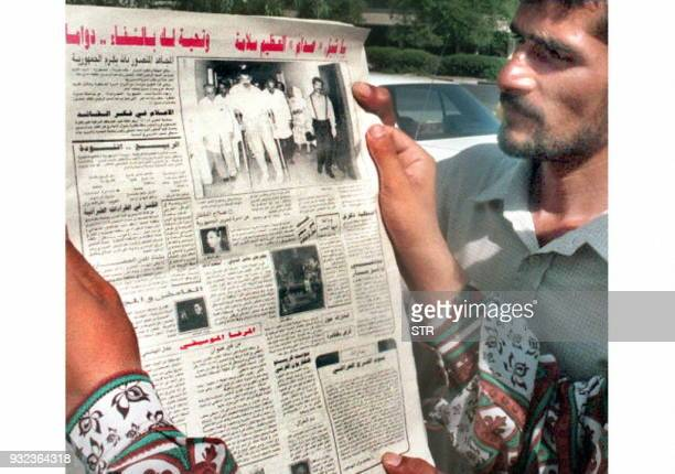 Two Iraqis read 10 June a newspaper which has the picture of President Saddam Hussien's son Uday leaving hospital on crutches The headline reads...