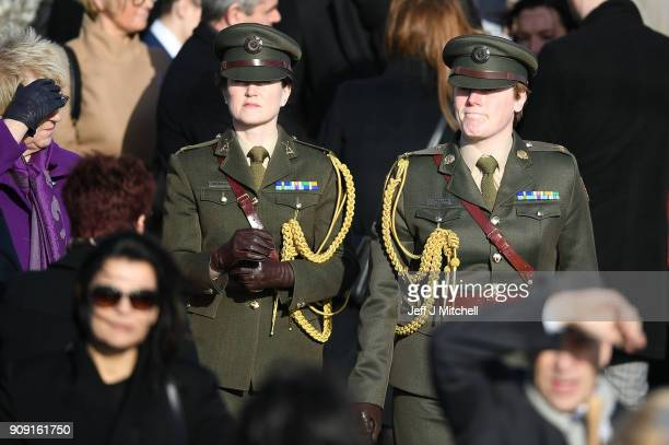 Two Irish army officers stand outside St Ailbe's parish church in Ballybricken after Dolores O'Riordan's funeral on January 23 2018 in Limerick...