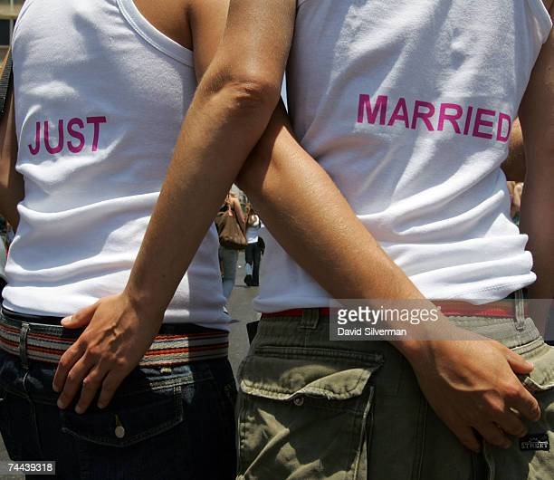 Two Israeli lesbians wear vests with the words Just Married written on them during the annual Gay Pride rally on June 8 2007 Tel Aviv Israel's most...