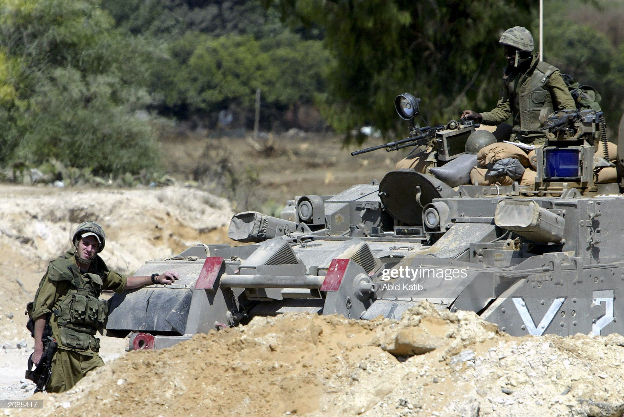 https://media.gettyimages.com/photos/two-israeli-soldiers-rest-near-their-tank-june-16-2003-at-the-to-the-picture-id2085417?s=2048x2048