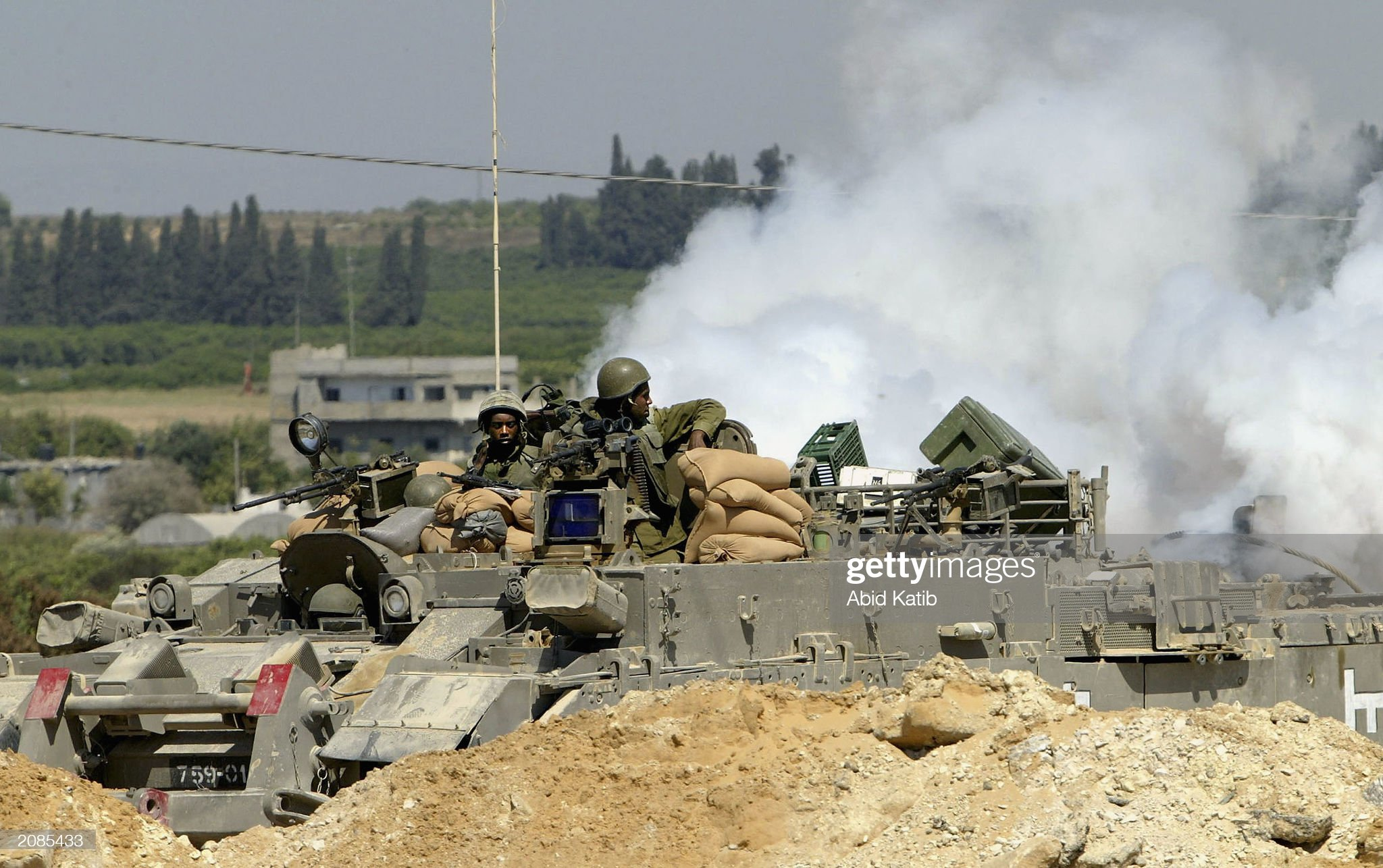 https://media.gettyimages.com/photos/two-israeli-soldiers-sit-in-their-tank-as-smoke-rises-from-the-rear-picture-id2085433?s=2048x2048