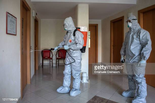 Two Italian Army officers belonging to the 7th CBRN Defense Regiment 'Cremona' spray Sodium hypochlorite inside a morgue in order to decontaminate it...