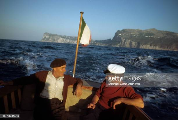 Two Italian men on a boat to the Island of Ischia from Capri Italy