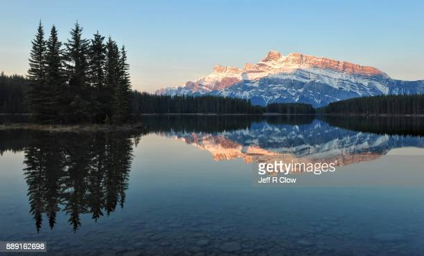 two jack lake at first light 2 - reflection lake stock photos and pictures