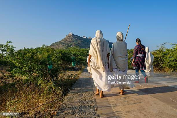 Two Jain nuns are walking the 3500 steps up to Shatrunjaya hill Shatrunjaya is one of the major pilgrim sites for Jains
