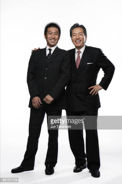 Two Japanese businessman looking at camera