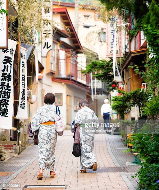 Two Japanese females in Yukata heading to the hot springs