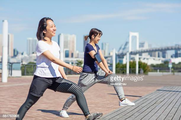 Two Japanese girls stretching in the morning at Tokyo