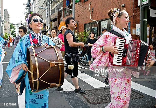 Two Japanese ladies with yukata and play instrument at the Tanabata festival on July 6 2013 in Tokyo Japan Tanabata is a Japanese star festival where...