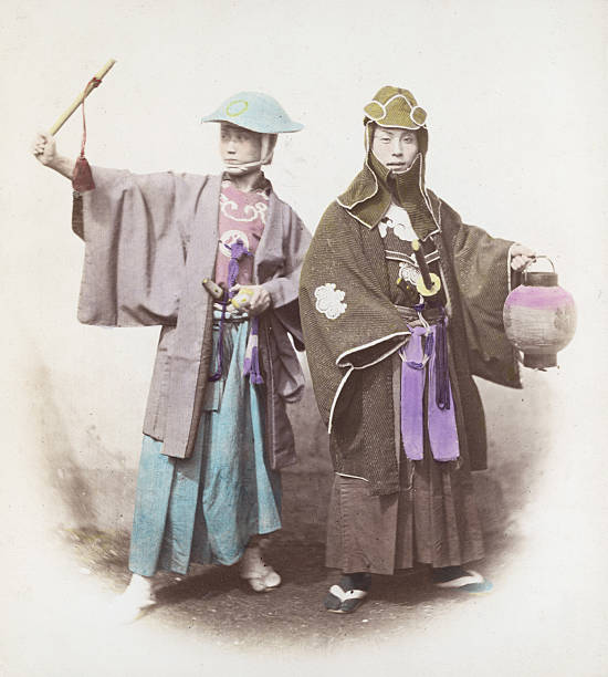 Two Japanese samurai in fire dress, circa 1865. The...