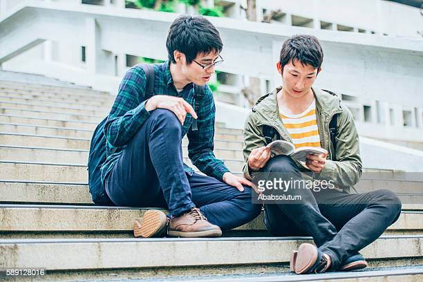 two japanese students reading on staircase, campus, kyoto, japan - anime stock photos and pictures