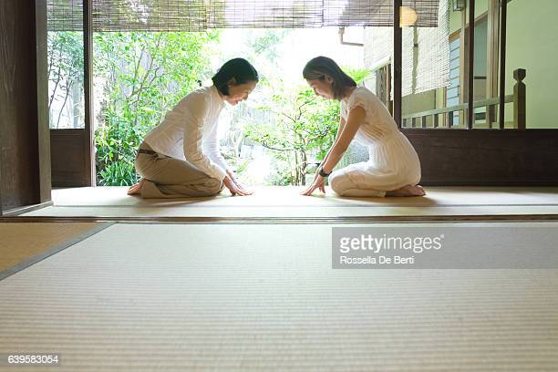 two japanese women bowing with respect - wabi sabi stock pictures, royalty-free photos & images