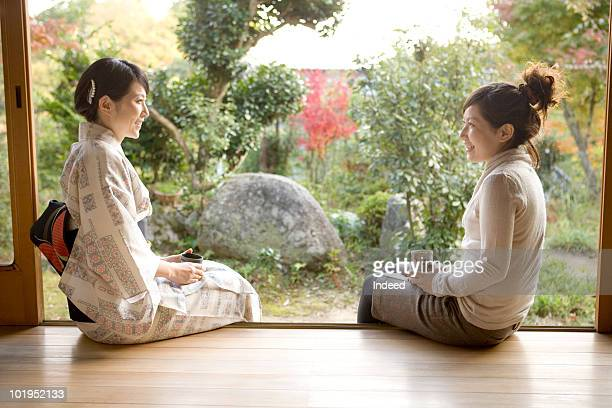 Two Japanese women talking on the veranda