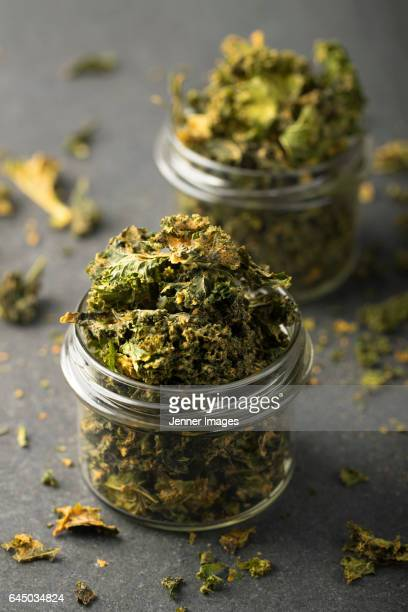 Two jars of baked kale chips.