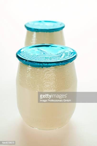 Two jars of yoghurt