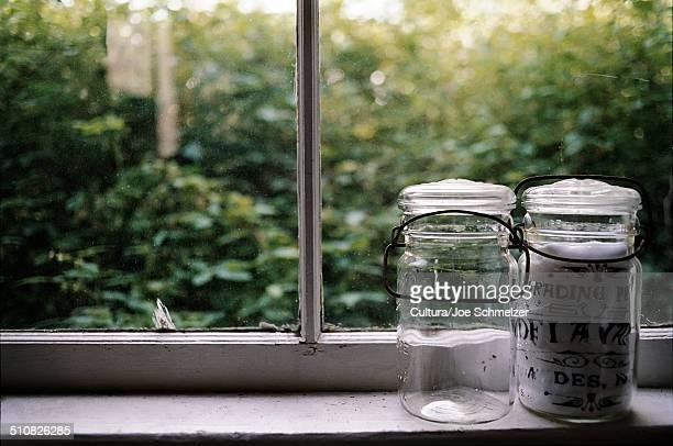 Two jars on a windowsill