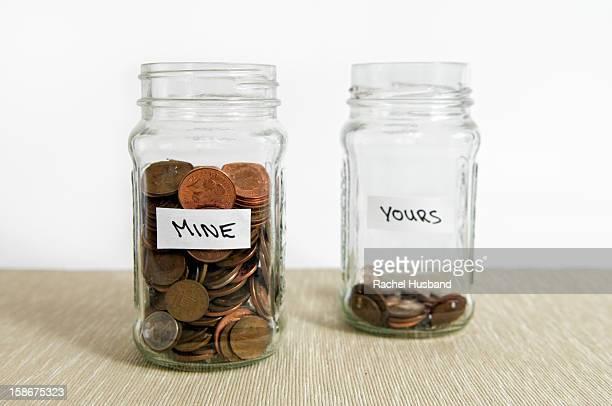 Two jars with loose change in sterling currency