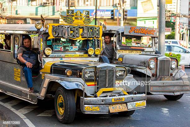 two jeepneys in metro manila. - jeepney stock pictures, royalty-free photos & images