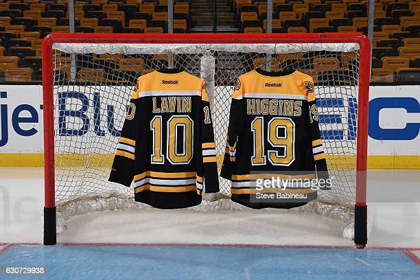 Two jerseys of local high school players who died in a car accident a week ago made in memory of them before the game of the Boston Bruins against...