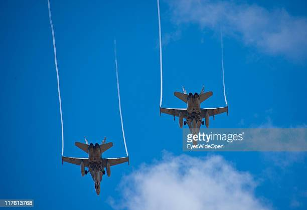 Two jet fighters flying next to each other in the blue sky on March 25, 2011 in Tenerife, Spain. Tenerife is the biggest of the canary islands and...