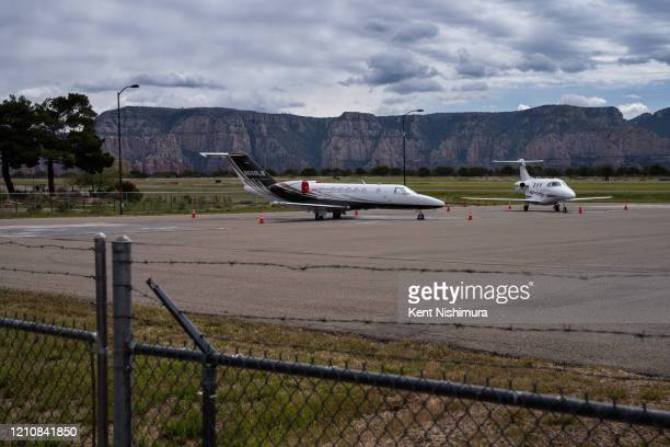 Two jets are seen parked at the Sedona Airport which is located atop a mesa overlooking the city on Tuesday April 21 2020 in Sedona AZ In early April...