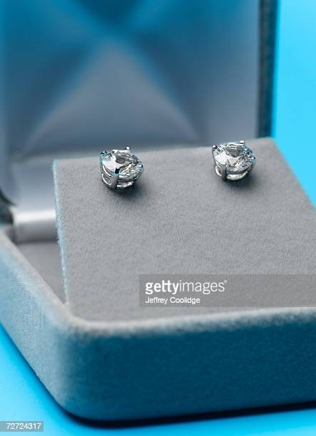 two jeweled ear studs in display box, close-up - earring stock pictures, royalty-free photos & images