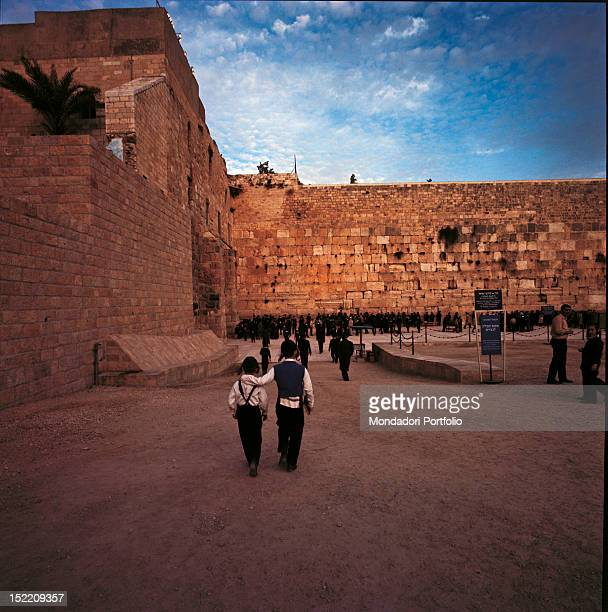 Two Jewish children with long ringlets setting off towards the promenade where 1900 years earlier the Temple of Solomon stood the older boy...