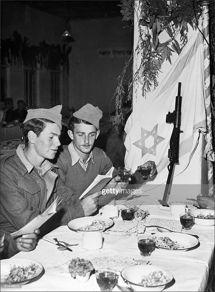 Two Jewish soldiers of Haganah, the Jewish Agency self-defence force, have a ritual Passover dinner, in late April 1948 in Jerusalem, while clashes between Haganah and Allied Arab forces continued. The 1948-49 first Israeli-Arab War reflected the opposition fo the Arab states to the formation of the Jewish state in what they considered to be Arab territory. As independence was declared 14 May 1948, Arab forces from Egypt, Syria, Transjordan (later Jordan), Lebanon and Iraq invaded Israel.