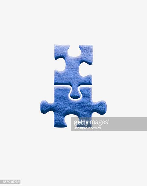 two jigsaw pieces joined together - two objects stock pictures, royalty-free photos & images