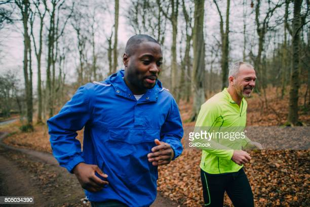 two joggers training for a marathon - only men stock pictures, royalty-free photos & images