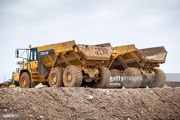 Two John Deere Articulated Dump Trucks