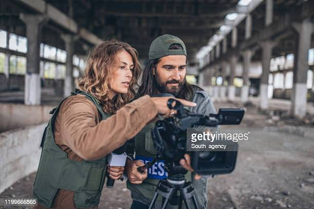 two journalists reporting from the war zone - war stock pictures, royalty-free photos & images